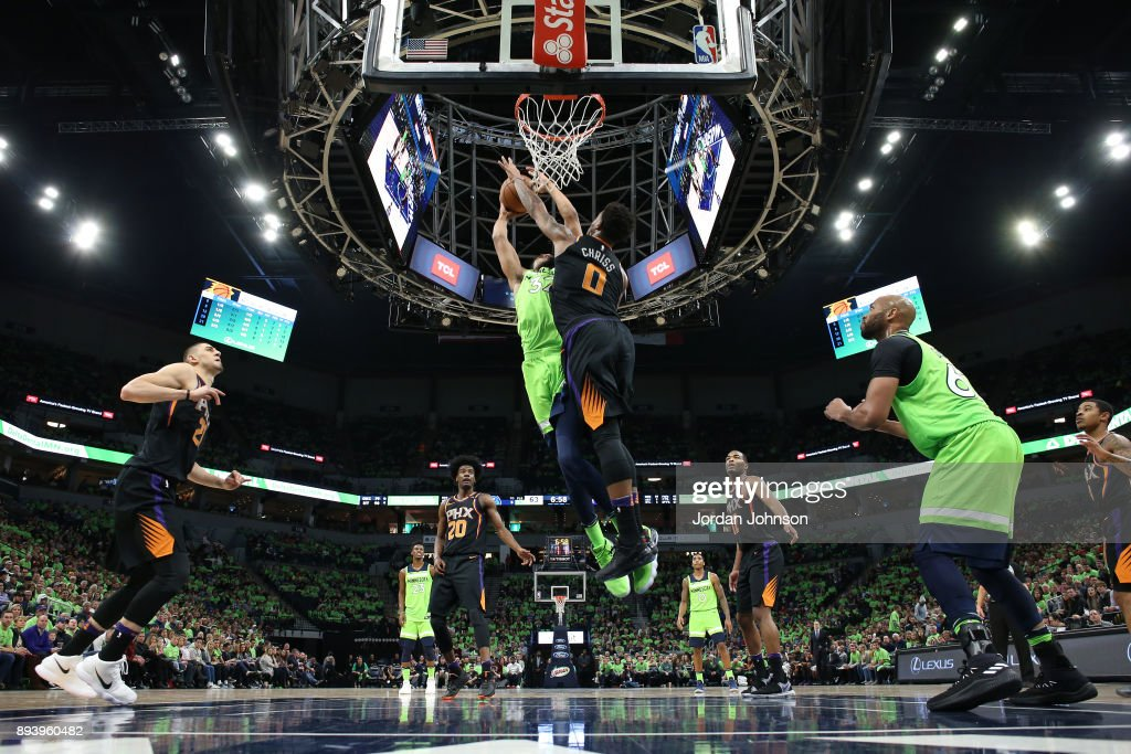 Karl-Anthony Towns #32 of the Minnesota Timberwolves shoots the ball against the Phoenix Suns on December 16, 2017 at Target Center in Minneapolis, Minnesota.