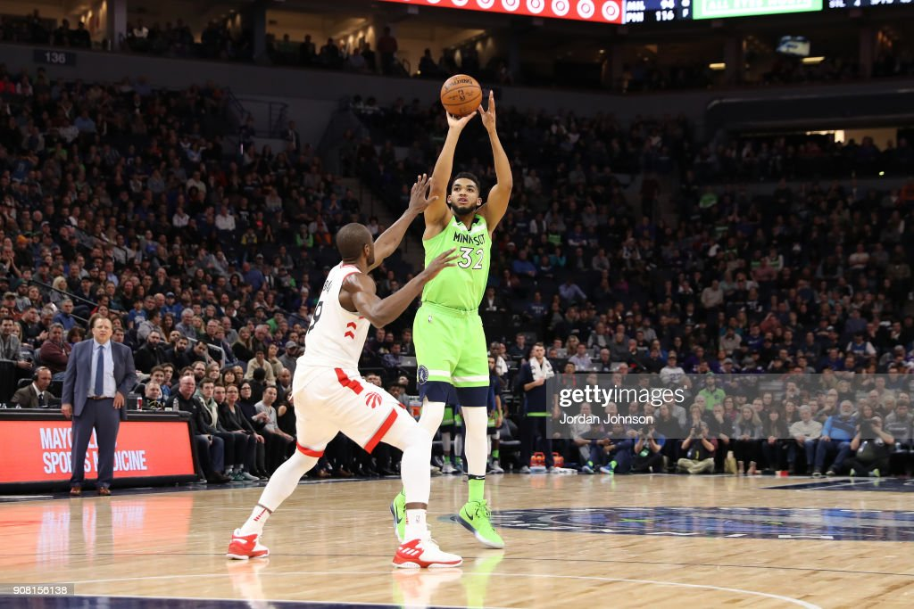 Karl-Anthony Towns #32 of the Minnesota Timberwolves shoots the ball against the Toronto Raptors on January 20, 2018 at Target Center in Minneapolis, Minnesota.