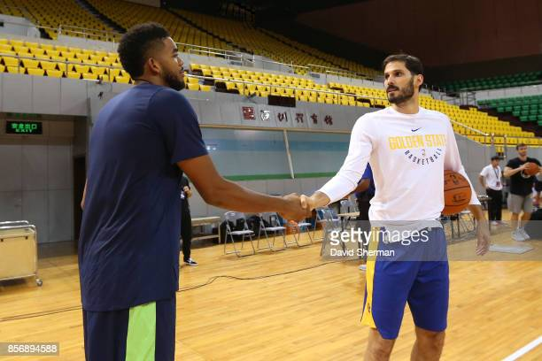 KarlAnthony Towns of the Minnesota Timberwolves talks with Omri Casspi of the Golden State Warriors during practice and media availability at...