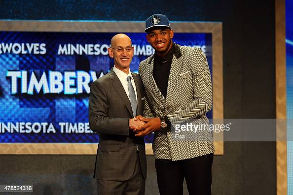 KarlAnthony Towns poses with Commissioner Adam Silver after being drafted first overall by the Minnesota Timberwolves in the First Round of the 2015...