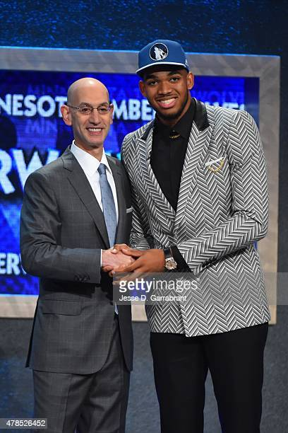 KarlAnthony Towns the pick overall in the 2015 NBA Draft by the Minnesota Timberwolves poses for a portrait with Adam Silver during the 2015 NBA...