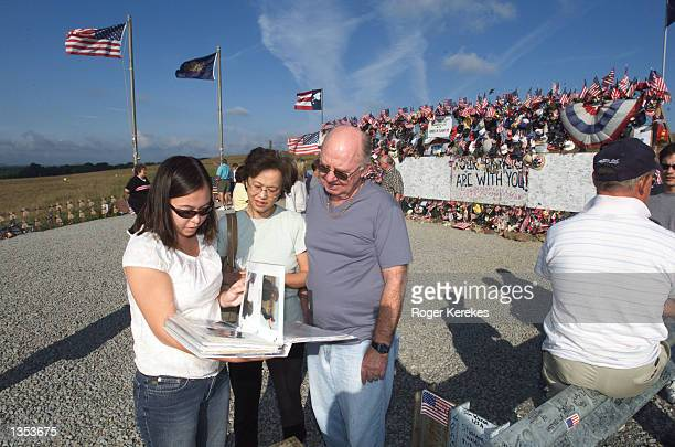 Karlee Decima of Los Angeles California and her parents Susan and Richard Decima of Vancouver British Columbia look over a scrap book prepared by...