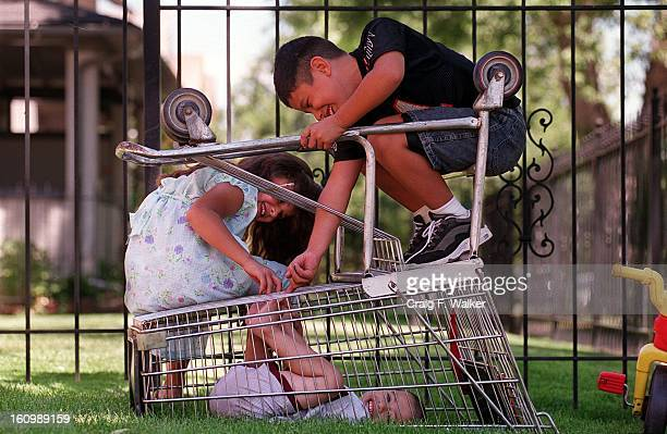 Karlene Sanchez and her brother John tickle the feet of their brother Allen while trapped in an over turned shopping cart The group was playing...