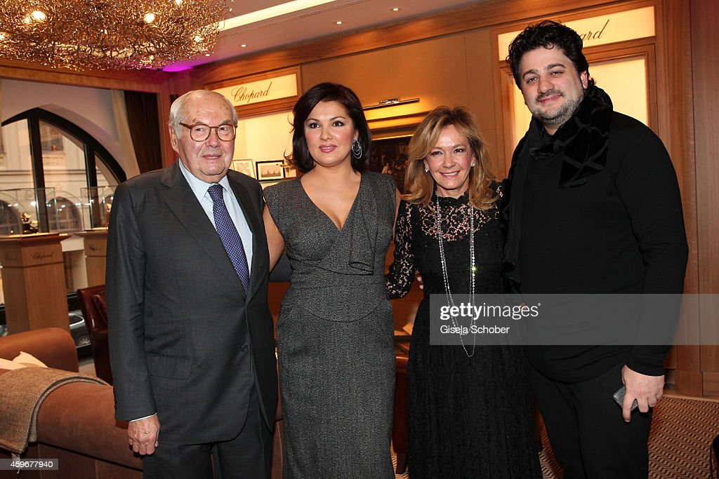 Karl-Friedrich Scheufele, <a gi-track='captionPersonalityLinkClicked' href=/galleries/search?phrase=Anna+Netrebko&family=editorial&specificpeople=732328 ng-click='$event.stopPropagation()'>Anna Netrebko</a>, Caroline Scheufele and Yusif Eyvazo pose during the Chopard Boutique re-opening on November 28, 2014 in Munich, Germany.