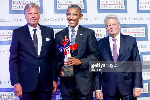 Karlheinz Koegel former US president Barack Obama with his award and former German president Joachim Gauck during the German Media Award 2016 at...
