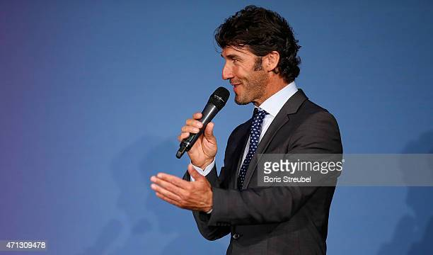 KarlHeinz Riedle UEFA Champions League final ambassador talks during the UEFA Champions League Trophy handover ceremony at Rote Rathaus on April 27...