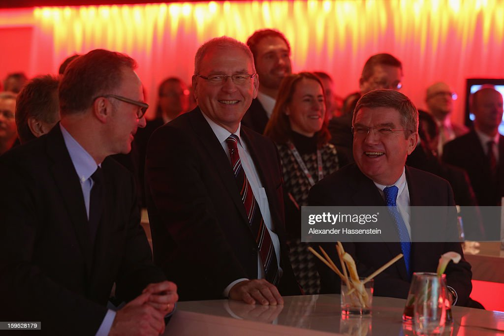 Karl-Heinz Rumenigge, Dr. Michael Vesper and Dr. Thomas Bach laugh during the DFL new year's reception at the Thurn und Taxis Palais on January 15, 2013 in Frankfurt am Main, Germany.