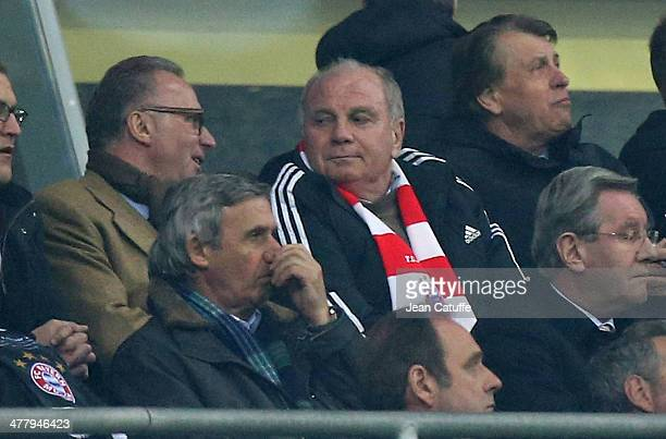 KarlHeinz Rummenigge and Uli Hoeness of Bayern Muenchen attend the UEFA Champions League Round of 16 match between FC Bayern Muenchen and Arsenal FC...