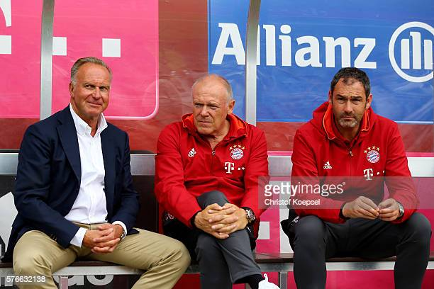 CEO KarlHeinz Rummenigge assistant coach Hermann Gerland and assistant coach Paul Clement of Bayern Muenchen sit on the bench prior to the friendly...