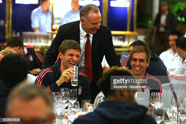 KarlHeinz Rummenigge CEO of Bayern Muenchen of Muenchen jokes with his players Thomas Mueller aand Philipp Lahm at the Champions Banquette at EPIC...
