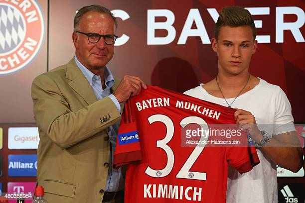 KarlHeinz Rummenigge CEO of Bayern Muenchen pose with the new player Joshua Kimmich during a press conference head of the FC Bayern Muenchen season...