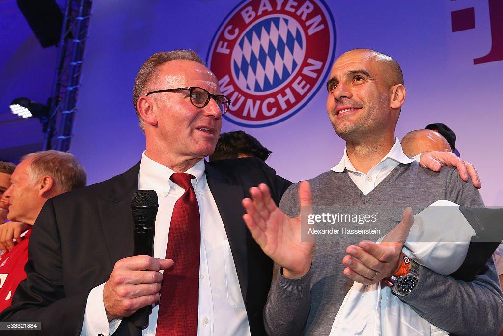 KarlHeinz Rummenigge CEO of Bayern Muenchen speaks to Josep Guardiola head coach of Bayern Muenchen at the FC Bayern Muenchen champions party at...