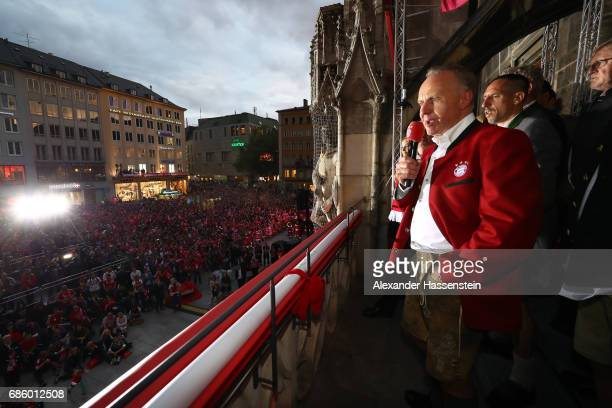 KarlHeinz Rummenigge CEO of Bayern Muenchen speaks to the fans as they celebrate winning the 67th German Championship title on the town hall balcony...