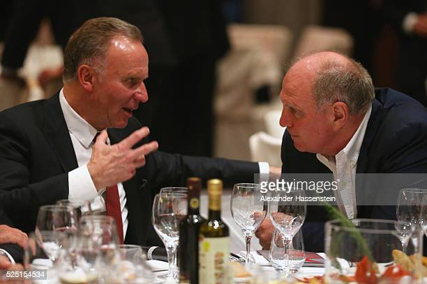 KarlHeinz Rummenigge CEO of Bayern Muenchen talks to Uli Hoeness during the Champions Banquette after the UEFA Champions League semi final first leg...