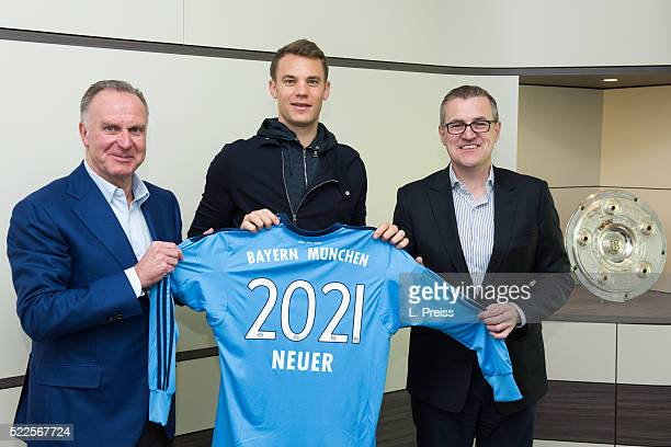 KarlHeinz Rummenigge CEO of FC Bayern Muenchen AG Manuel Neuer and JanChristian Dreesen CFO of FC Bayern Muenchen pose after signing an extension to...