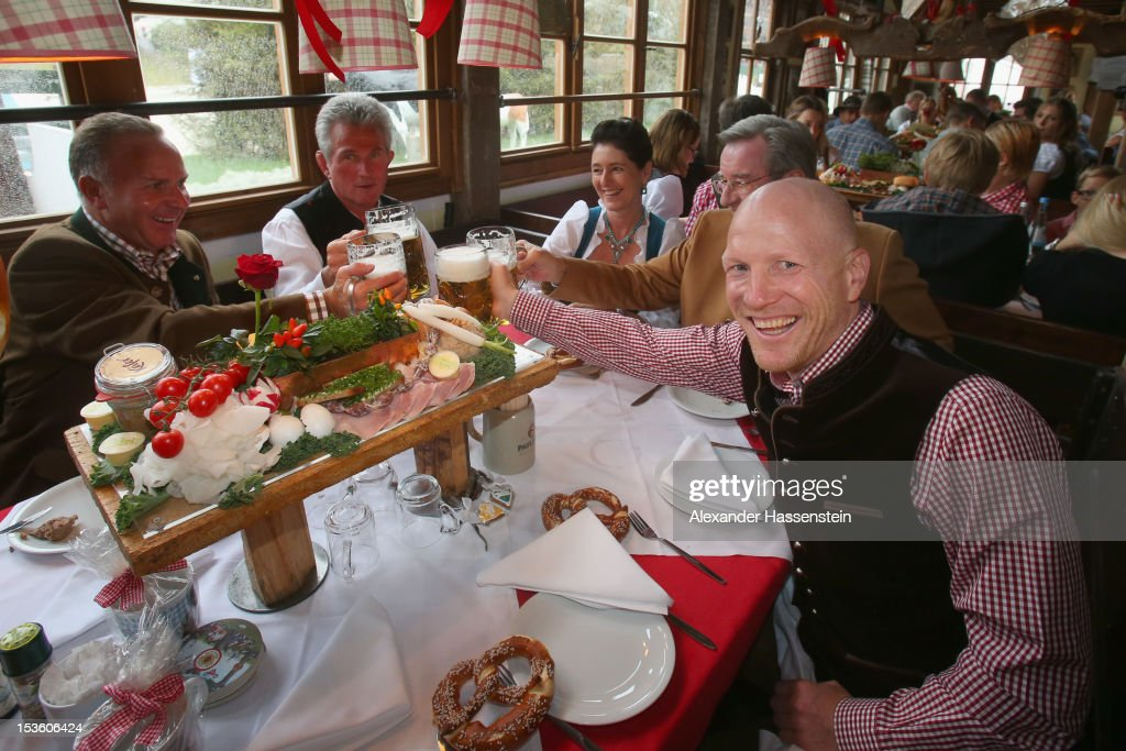 <a gi-track='captionPersonalityLinkClicked' href=/galleries/search?phrase=Karl-Heinz+Rummenigge&family=editorial&specificpeople=634867 ng-click='$event.stopPropagation()'>Karl-Heinz Rummenigge</a> (L), CEO of FC Bayern Muenchen attends with <a gi-track='captionPersonalityLinkClicked' href=/galleries/search?phrase=Jupp+Heynckes&family=editorial&specificpeople=2062040 ng-click='$event.stopPropagation()'>Jupp Heynckes</a> (2nd L), head coach of FC Bayern Muenchen, <a gi-track='captionPersonalityLinkClicked' href=/galleries/search?phrase=Karl+Hopfner&family=editorial&specificpeople=635248 ng-click='$event.stopPropagation()'>Karl Hopfner</a> (2nd R), CFO of FC Bayern Muenchen and <a gi-track='captionPersonalityLinkClicked' href=/galleries/search?phrase=Matthias+Sammer&family=editorial&specificpeople=555228 ng-click='$event.stopPropagation()'>Matthias Sammer</a> (R), sporting director of FC Bayern Muenchen the Oktoberfest beer festival at the Kaefer Wiesnschaenke tent on October 7, 2012 in Munich, Germany.