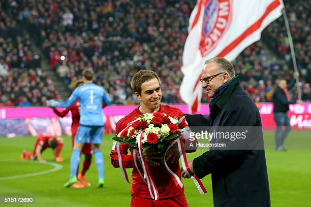 KarlHeinz Rummenigge CEO of FC Bayern Muenchen hands over flowers to his player Phiilipp Lahm for his 300th Bundesliga match prior to the Bundesliga...