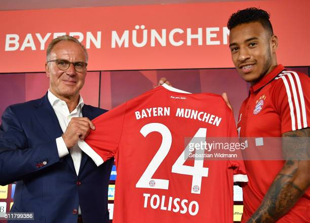 KarlHeinz Rummenigge CEO of FC Bayern Muenchen presents with Corentin Tolisso his new jersey number at Saebener Strasse training ground on July 10...