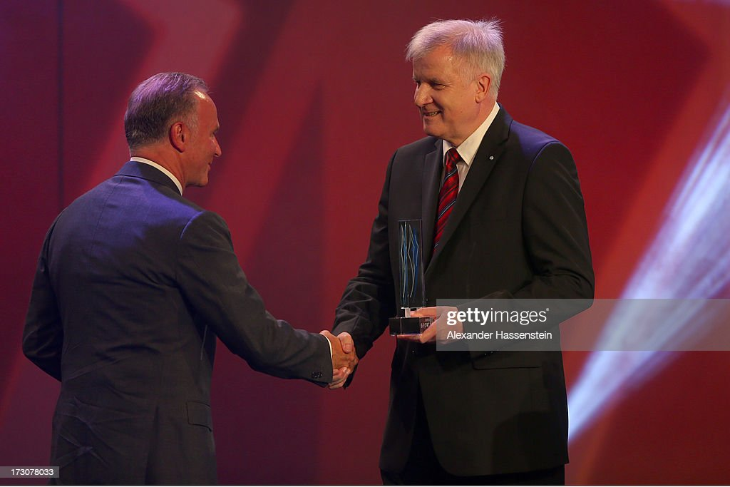 <a gi-track='captionPersonalityLinkClicked' href=/galleries/search?phrase=Karl-Heinz+Rummenigge&family=editorial&specificpeople=634867 ng-click='$event.stopPropagation()'>Karl-Heinz Rummenigge</a>, CEO of FC Bayern Muenchen receives the Bavarian Sportaward 2013 from Bavarian state governor <a gi-track='captionPersonalityLinkClicked' href=/galleries/search?phrase=Horst+Seehofer&family=editorial&specificpeople=4273631 ng-click='$event.stopPropagation()'>Horst Seehofer</a> (R), during the Bavarian Sport Award gala at BMW Welt on July 6, 2013 in Munich, Germany.