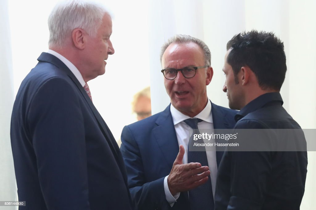 Karl-Heinz Rummenigge (C), CEO of FC Bayern Muenchen talks to Horst Seehofer, Bavarian Governor and Hasan Salihamidzic, Sporting director of FC Bayern Muenchen during the opening ceremony of the FC Bayern Campus at FC Bayern Campus on August 21, 2017 in Munich, Germany.