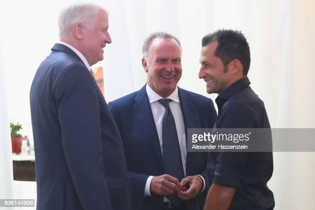 KarlHeinz Rummenigge CEO of FC Bayern Muenchen talks to Horst Seehofer Bavarian Governor and Hasan Salihamidzic Sporting director of FC Bayern...