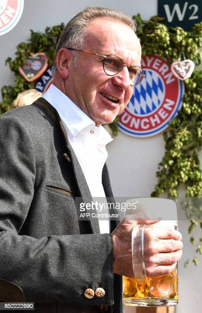 KarlHeinz Rummenigge CEO of German first division Bundesliga football club FC Bayern Munich holds a beer mug as he poses during the traditional visit...