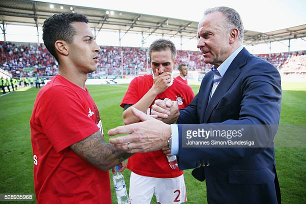 KarlHeinz Rummenigge member of the board of Bayern Muenchen congratulates Thiago after winning the Bundesliga match between FC Ingolstadt and FC...