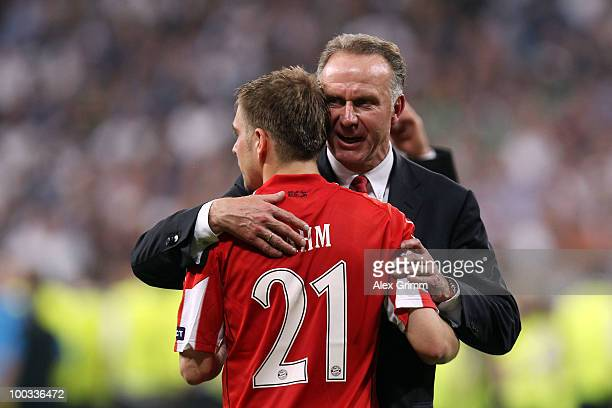 KarlHeinz Rummenigge of Bayern Muenchen comforts Philipp Lahm after their defeat at the end of the UEFA Champions League Final match between FC...