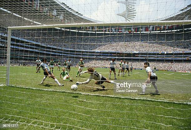 KarlHeinz Rummenigge of West Germany scores the first goal for West Germany against Argentina during the FIFA World Cup final on 29 June 1986 at the...