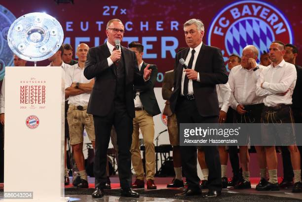 KarlHeinz Rummenigge talks to head coach Carlo Ancelotti during the Bayern Muenchen Championship party following the Bundesliga match between Bayern...