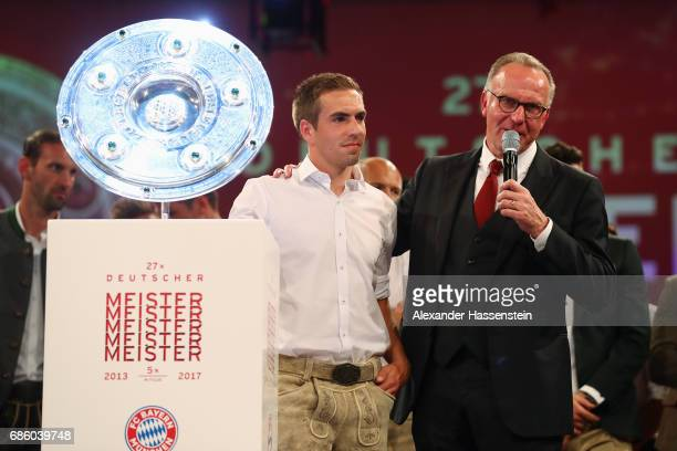 KarlHeinz Rummenigge talks to Philipp Lahm during the FC Bayern Muenchen Championship party following the Bundesliga match between Bayern Muenchen...