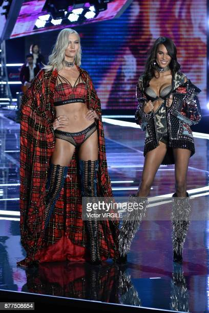 Karlie Kloss and Cindy Bruna walk the runway at the 2017 Victoria's Secret Fashion Show In Shanghai Show at MercedesBenz Arena on November 20 2017 in...