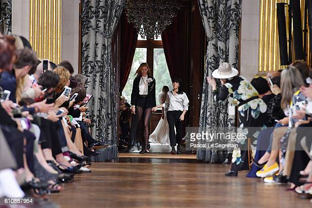 Karlie Kloss and designer Bouchra Jarrar walk the runway during the Lanvin show as part of the Paris Fashion Week Womenswear Spring/Summer 2017 on...