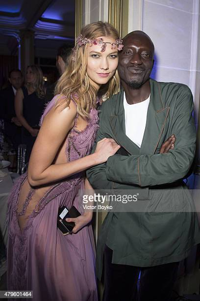 Karlie Kloss and JenkeAhmed Tailly attend the amfAR dinner at the Pavillon LeDoyen during the Paris Fashion Week Haute Couture on July 5 2015 in...
