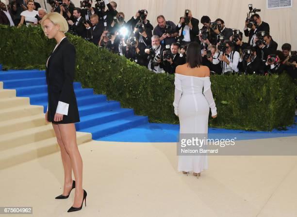 Karlie Kloss and Kim Kardashian West attends the 'Rei Kawakubo/Comme des Garcons Art Of The InBetween' Costume Institute Gala at Metropolitan Museum...