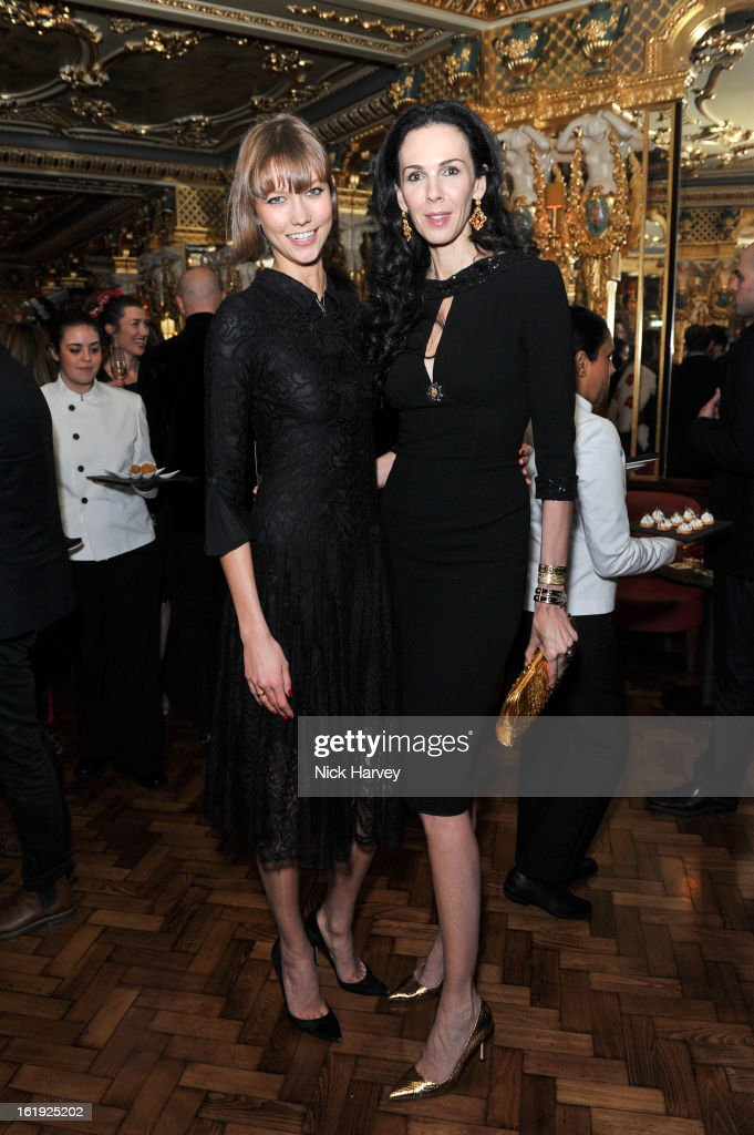 <a gi-track='captionPersonalityLinkClicked' href=/galleries/search?phrase=Karlie+Kloss&family=editorial&specificpeople=5555876 ng-click='$event.stopPropagation()'>Karlie Kloss</a> and <a gi-track='captionPersonalityLinkClicked' href=/galleries/search?phrase=L%27Wren+Scott+-+Fashion+Designer&family=editorial&specificpeople=566708 ng-click='$event.stopPropagation()'>L'Wren Scott</a> attend the <a gi-track='captionPersonalityLinkClicked' href=/galleries/search?phrase=L%27Wren+Scott+-+Fashion+Designer&family=editorial&specificpeople=566708 ng-click='$event.stopPropagation()'>L'Wren Scott</a> cocktail party during London Fashion Week Fall/Winter 2013/14 at on February 17, 2013 in London, England.