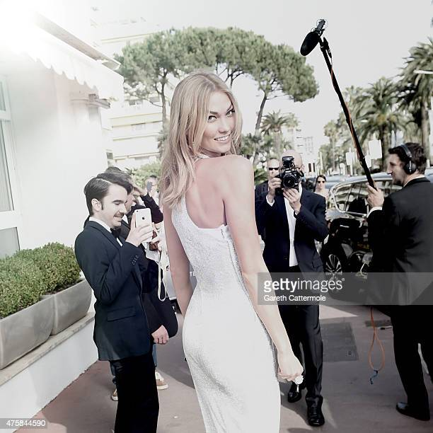 Karlie Kloss departs the Martinez Hotel during the 68th annual Cannes Film Festival on May 13 2015 in Cannes France