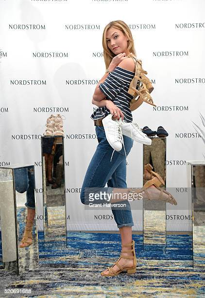 Karlie Kloss displays a section of shoes from Nordstrom on April 12 2015 in Columbia South Carolina Kloss and Nordstrom took over the University of...