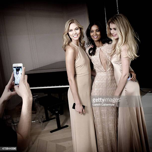 Karlie Kloss Liya Kebede and Doutzen Kroes pose backstage during filming for L'Oreal during the 68th annual Cannes Film Festival on May 13 2015 in...