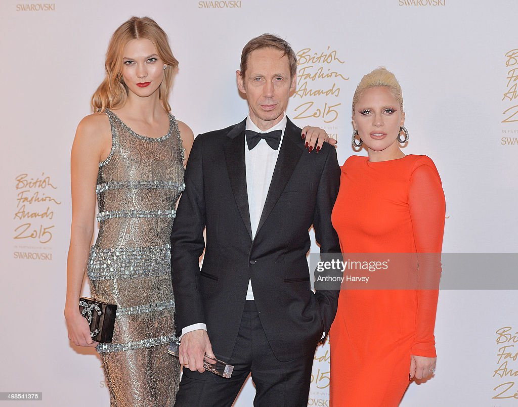 Karlie Kloss, Nick Knight and Lady Gaga pose in the Winners Room at the British Fashion Awards 2015 at London Coliseum on November 23, 2015 in London, England.