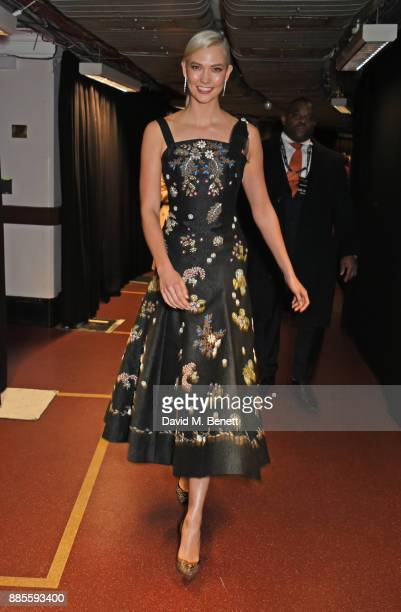 Karlie Kloss poses in the Winners Room at The Fashion Awards 2017 in partnership with Swarovski at Royal Albert Hall on December 4 2017 in London...