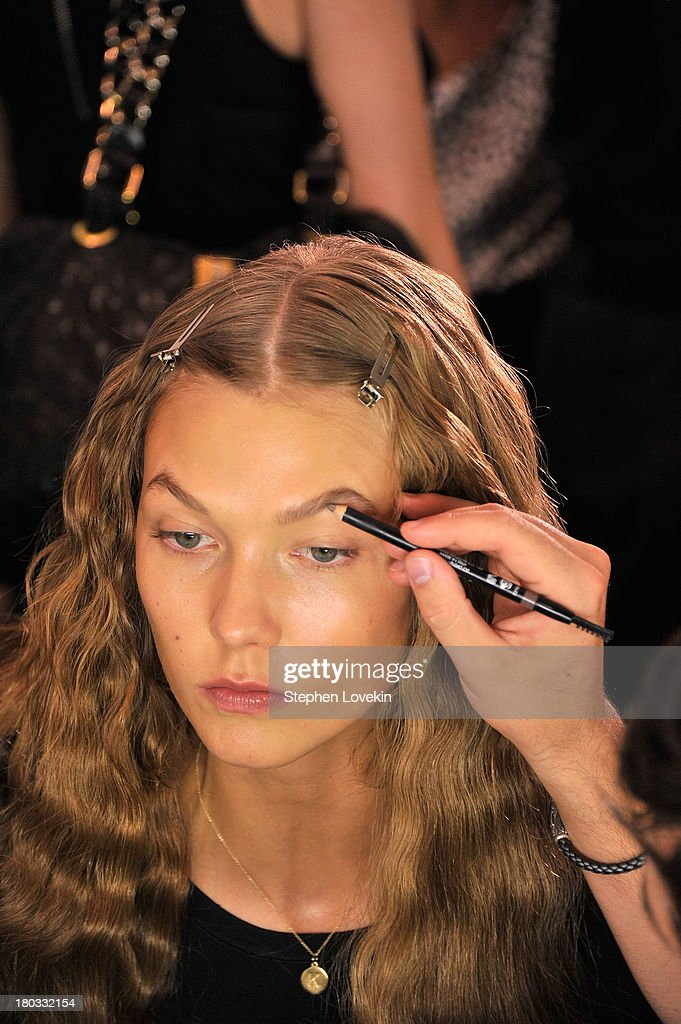 <a gi-track='captionPersonalityLinkClicked' href=/galleries/search?phrase=Karlie+Kloss&family=editorial&specificpeople=5555876 ng-click='$event.stopPropagation()'>Karlie Kloss</a> prepares backstage at the Anna Sui fashion show during Mercedes-Benz Fashion Week Spring 2014 at The Theatre at Lincoln Center on September 11, 2013 in New York City.