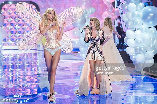Karlie Kloss walks the runway as Taylor Swift performs at the annual Victoria's Secret fashion show at Earls Court on December 2 2014 in London...