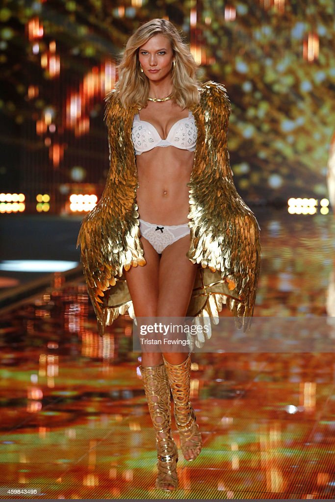 Karlie Kloss walks the runway at the 2014 Victoria's Secret Runway Show Swarovski Crystal Looks at Earl's Court Exhibition Centre on December 2 2014...