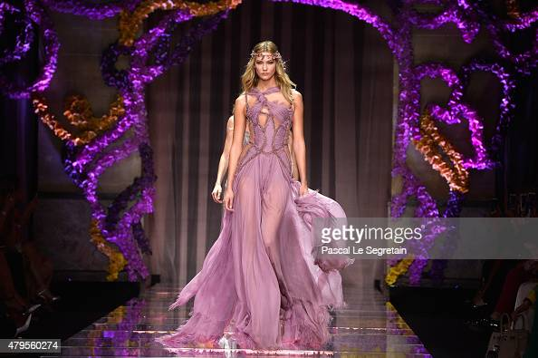 Karlie Kloss walks the runway during the Atelier Versace show as part of Paris Fashion Week Haute Couture Fall/Winter 2015/2016 on July 5 2015 in...