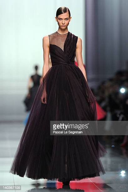 Karlie Kloss walks the runway during the Christian Dior ReadyToWear Fall/Winter 2012 show as part of Paris Fashion Week at Musee Rodin on March 2...