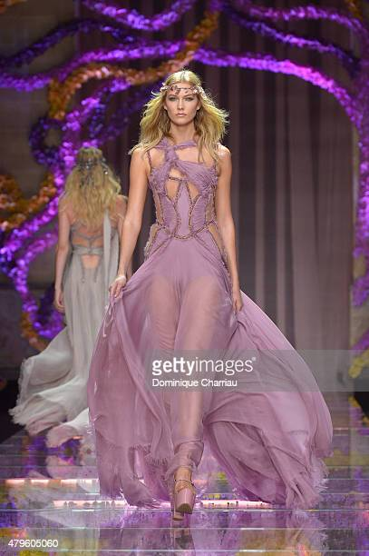 Karlie Kloss walks the runway during the Versace show as part of Paris Fashion Week Haute Couture Fall/Winter 2015/2016 on July 5 2015 in Paris France
