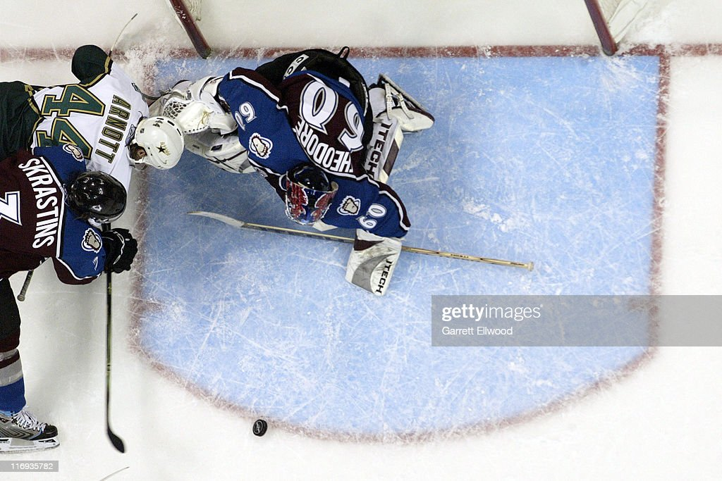 Karlis Skrastins of the Colorado Avalanche holds off Jason Arnott of the Dallas Stars in front of Jose Theodore of the Colorado Avalanche during Game...
