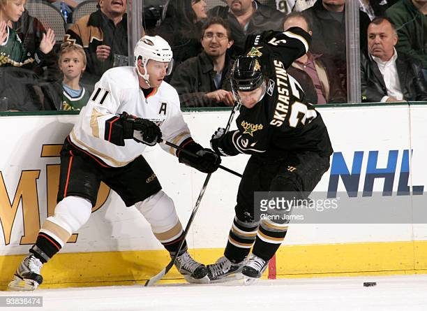 Karlis Skrastins of the Dallas Stars tries to keep the puck away against Saku Koivu of the Anaheim Ducks on December 3 2009 at the American Airlines...