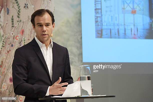 KarlJohan Persson CEO of Swedish retail giant HM presents the company's fourth quarter financial report during a press conference at the company's...